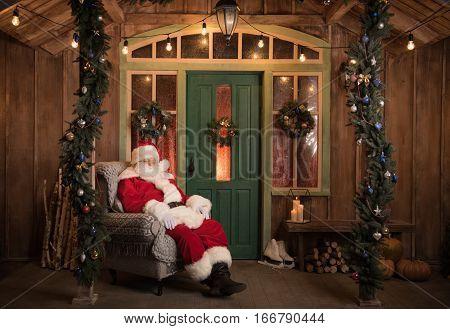 Santa Claus sleeping in grey armchair at Christmas time