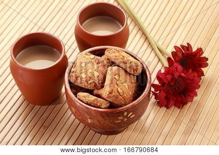 Indian Handmade Pottery Tea Glasses with Biscuits