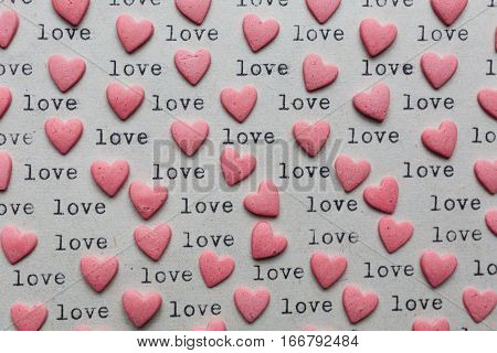 Heart shaped candy with loving words on the paper made with typewriter