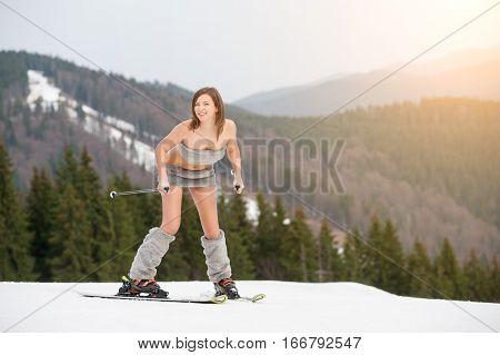 Naked Girl Skier Starting Skiing On The Snowy Slope