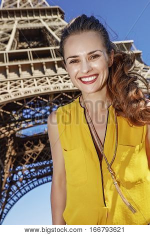Happy Woman Against Eiffel Tower In Paris, France