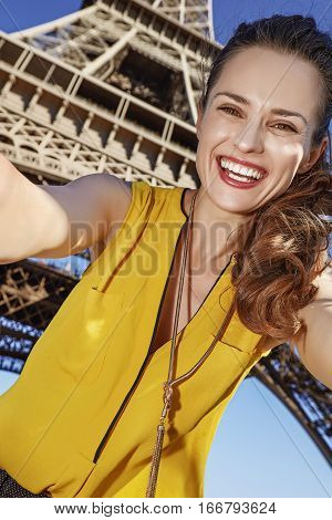 Happy Woman Taking Selfie Against Eiffel Tower In Paris, France