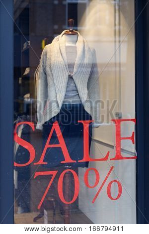 fashion doll with dress for women during sale and seventy percent discount in clothing store