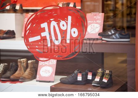 shoes for sale and discount in shoe shop display window