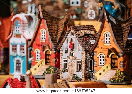 Tallinn, Estonia - December 2, 2016: Traditional Souvenirs Small House Toys At European Market. Funny Souvenir From Tallinn, Estonia, Europe.