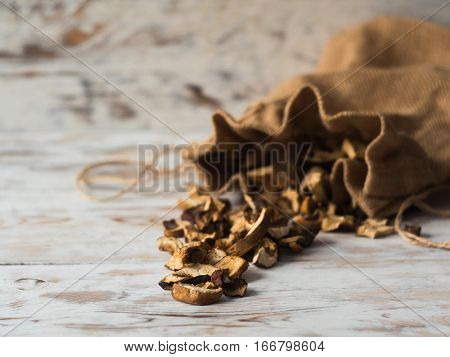 Dried forest Mushrooms closeup on Rustic Wooden background. Side View