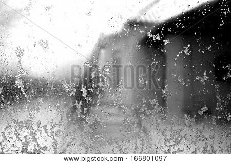 Window In Snow With Blur Effect In Black And White