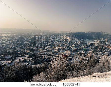 retro beautiful view of a winter city from atop the mountain
