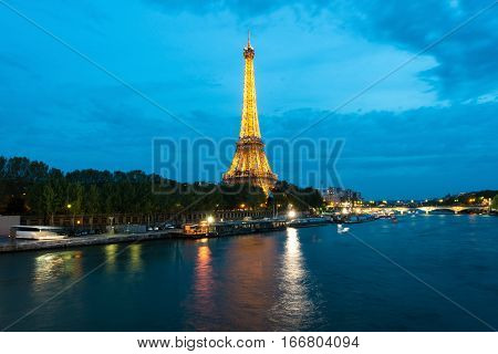 PARIS FRANCE - May 8 2016: Beautiful Paris view of Illuminations Eiffel tower at dusk Paris France.