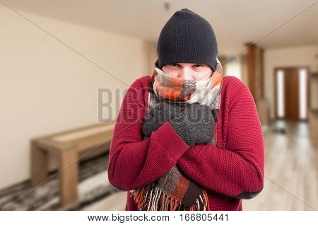 Cold Sick Man Dressed In Warm Clothes