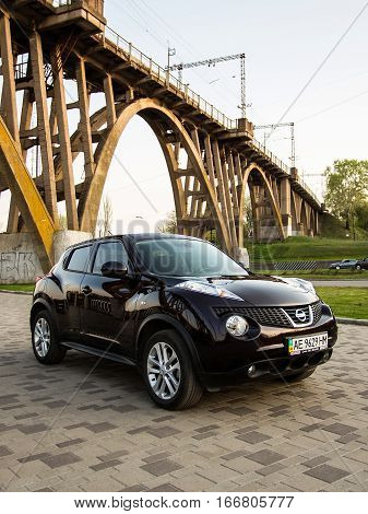 DNIPRO UKRAINE - APRIL 12 2016: NISSAN JUKE IN CITY UNDER THE BRIDGE