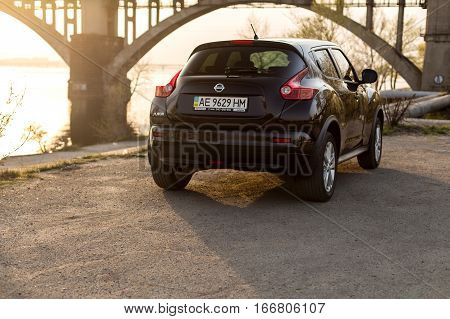 DNIPRO UKRAINE - APRIL 12 2016: NISSAN JUKE NEAR THE EMBANKMENT AT SUNSET