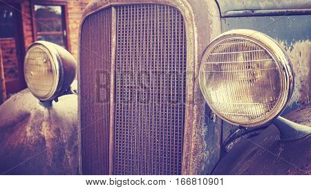 Color Toned Close Up Picture Of An Old Rusty Car Headlamps.