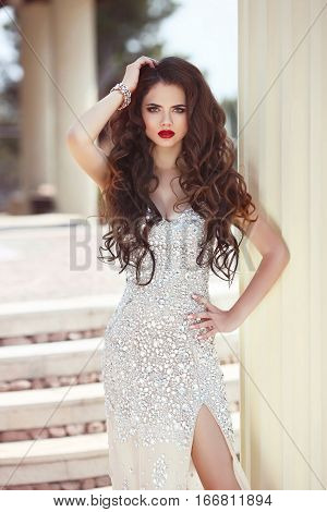Hair. Beautiful Brunette Woman In Fashion Dress, Elegant Lady In Expensive Beaded Wedding Gown. Beau