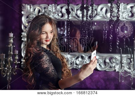 Beautiful Smiling Girl Making Selfie In Luxury Modern Interior. Attractive Female Taken Pictures Of