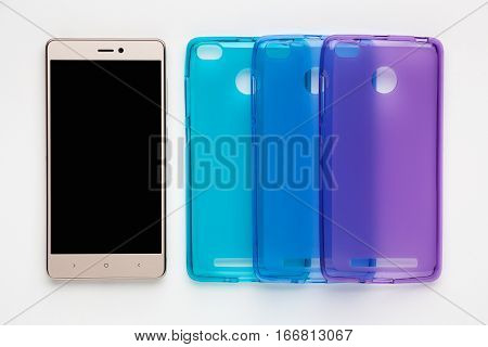 Set of colored silicone covers for smartphone on a white background