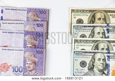 Close up view of US Dollar and Malaysia Ringgit indicating strong currency exchange rate