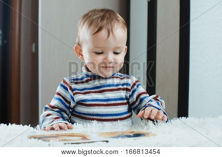 The child looks the book is very passionate about his occupation like