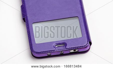 Smartphone in a  purple leather case with a window, close-up isolated on white background