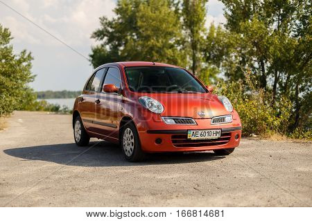 DNIPRO UKRAINE - AUGUST 10 2016: NISSAN MICRA NEAR THE RIVER