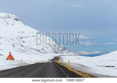 Mountain pass scenery from road 92 winding through the snowy hills of East Iceland