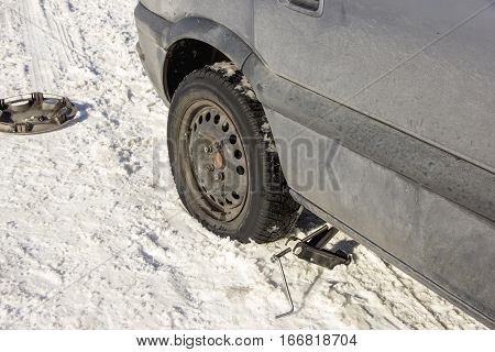 flat tire in the winter snow road