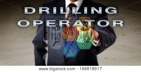 Human resources manager in blue business suit is pushing DRILLING OPERATOR on an interactive virtual remote control monitor. Oil and gas industry job concept for a role in drilling operations.