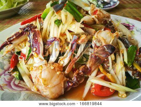 Closeup Papaya salad with blue swiming crab