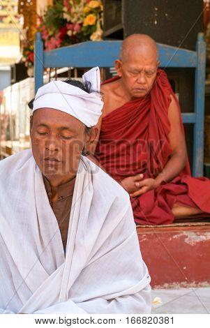 Yangon Myanmar - 9 January 2010: Monks on meditation at the Sule Paya Pagoda in Yangon on Myanmar