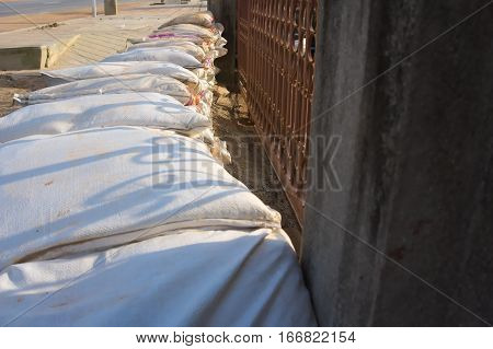 The packing sacks of sand using a stacking to prevent flooding into homes.