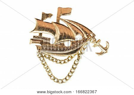 Golden ship figurine isolated over white background