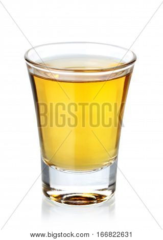 Glass of tequila shot isolated on white background