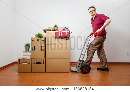 Man Is Packing Boxes On A Sack Barrow
