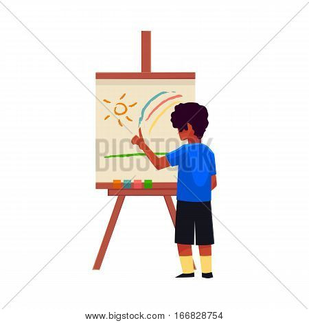 Little boy painting sun and rainbow on easel with his fingers, cartoon vector illustration on white background. Teenage boy standing and finger-painting, drawing, painting sun and rainbow on easel