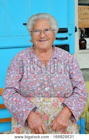 PEDOULAS, CYPRUS - NOVEMBER 15, 2015: Portrait of a smiling old woman in Troodos Mountains