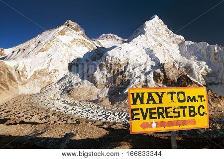 Evening view of signpost way to mount everest b.c. and Mount Everest Lhotse and Nuptse from Pumo Ri base camp way to Mount Everest base camp Nepal