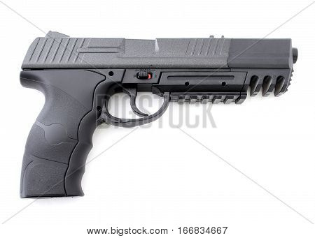 Black handgun pistol on a white background