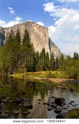 El Capitan viewed from across the Merced River in the valley floor of Yosemite National Park California USA.