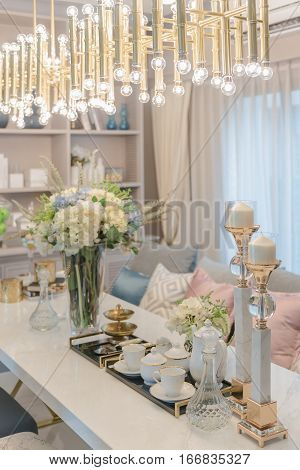Luxury Table Set On Dinnig Table With Vase Of Flower In Dining Room
