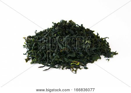 Dried japanese wakame seaweed isolated on white background