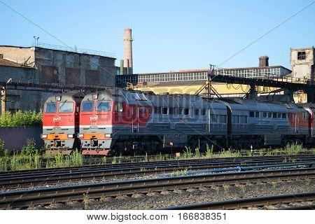 RYBINSK, RUSSIA - JULY 10, 2016: Two freight diesel locomotive 2TE116 locomotive depot train station Rybinsk