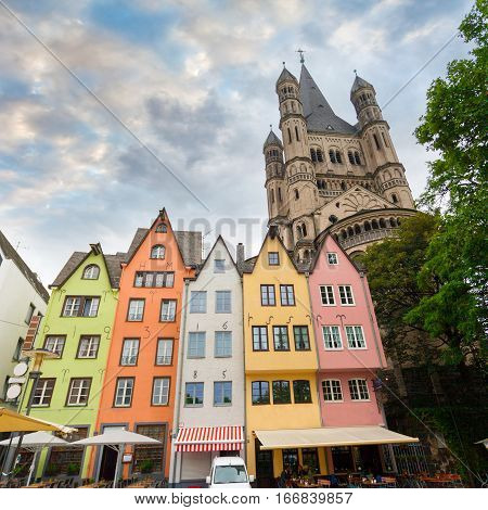 Great St. Martin Church and colorful houses in Bavarian style of Cologne. Cologne, North Rhine-Westphalia, Germany.
