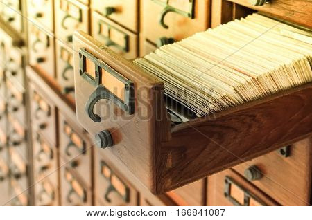 Vintage color image for open wooden boxes with index cards in library, Selective focus and Close up image