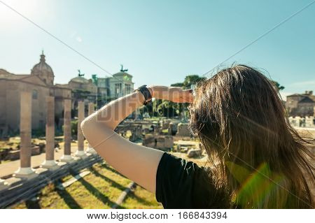 Woman Looking Forward With Hand On Forehead To Archeological Ruins In Rome