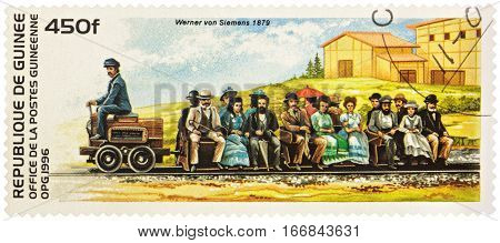 MOSCOW RUSSIA - January 26 2017: A stamp printed in Guinea shows electric railway of Siemens Company on the Berlin Exhibition in 1879 series