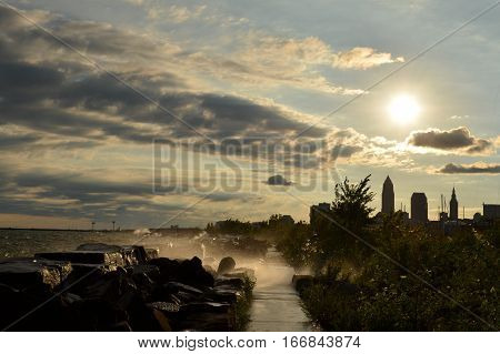 Breaking waves on Edgewater beach with Cleveland Skyline
