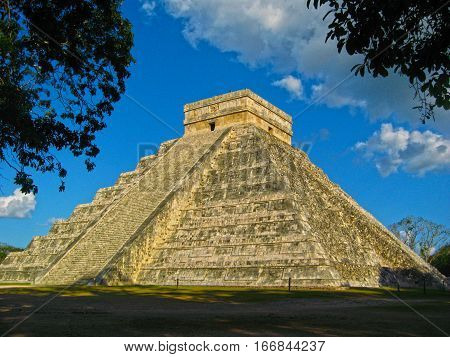 Chichen Itza, Mayan pyramid ruins on a blue sky day