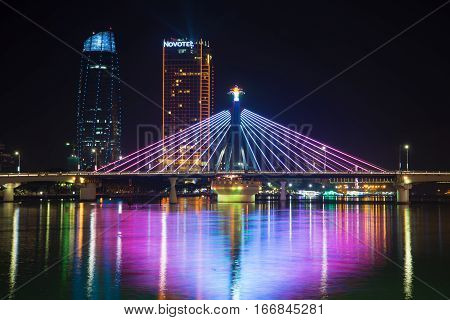 DA NANG, VIETNAM - JANUARY 05, 2016: South bridge on the Han river at night illumination