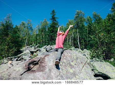 Happy Little Girl In The Mountain With Hands Raised To The Sun