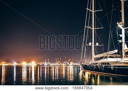 Luxury Yacht In La Spezia At Night With Reflection In Water